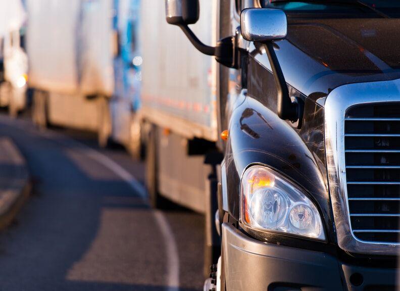 Line of semi-trucks driving